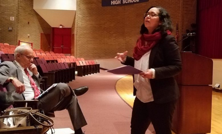 Prince George's County School board member Lupi Quinteros-Grady speaks during a Jan. 11 meeting in Greenbelt at which state Sen. Paul Pinsky (left) gave updates on recommendations to a statewide plan for school funding. (William J. Ford/The Washington Informer)