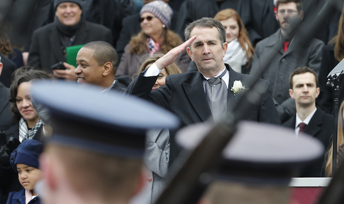 Virginia Gov. Ralph Northam, alongside Lt. Gov. Justin Fairfax (left), salutes Virginia Military Corp Cadets during his inauguration at the State Capitol in Richmond on Jan. 13. (Courtesy of virginiademocrats.com)