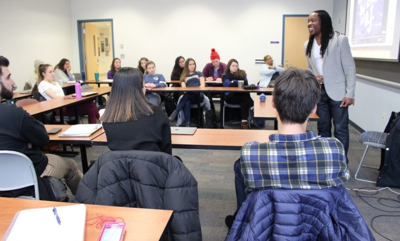 """Omékongo Dibinga teaches """"Jay-Z and the Practice of Historical Biography"""" at American University. (Brigette White/The Washington Informer)"""