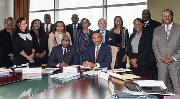 Morgan State University announces a contract extension for President David Wilson (seated, left) on Feb. 7. (Courtesy of Morgan State University)