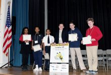 Cluster Bee winner Teddy Palmore (third from right) and runner-up Robert Foster (right) stand with some of the spellers who will be participating in The Washington Informer's 35th Annual Spelling Bee. The Cluster Bee, held Feb. 8 at Langley Education Center in Northeast, ran 53 rounds and was purported as one of the longest in the history of the event. (Roy Lewis/The Washington Informer)