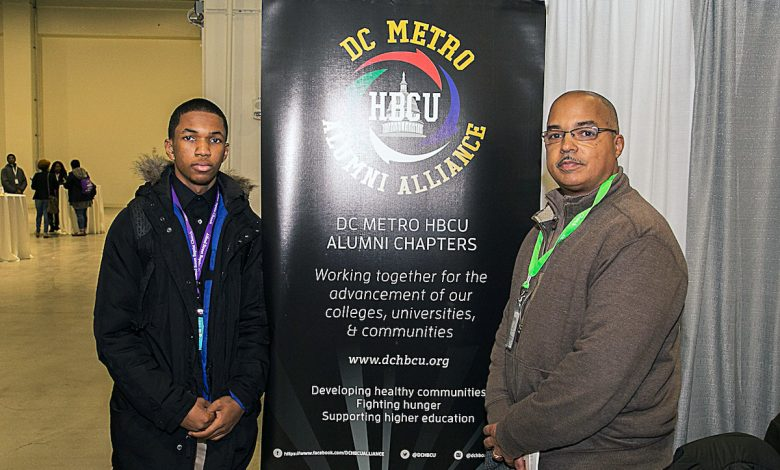 Jelani Jackson, a junior at Bishop McNamara High School in Forestville, Maryland, and his father, John Jackson, an engineer and Howard University graduate (Mark Mahoney/The Washington Informer)