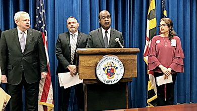 Montgomery County Executive Isiah Leggett (center) speaks at a Feb. 7 press conference announcing the county's lawsuit against opioid manufacturers and distributors. (Courtesy of Andrew Metcalf)