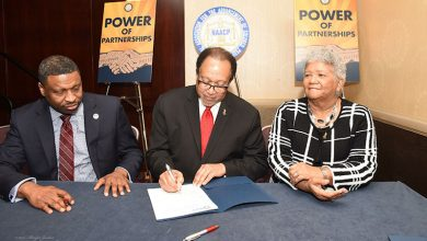 Dr. Benjamin F. Chavis Jr. (center), president and CEO of the NNPA, signs a historic agreement with the NAACP, designed to help mobilize voters for midterm elections and to increase membership for the 109-year-old organization, as NAACP President and CEO Derrick Johnson (left) and Dorothy Leavell, chairman of the NNPA, look on. (NAACP)