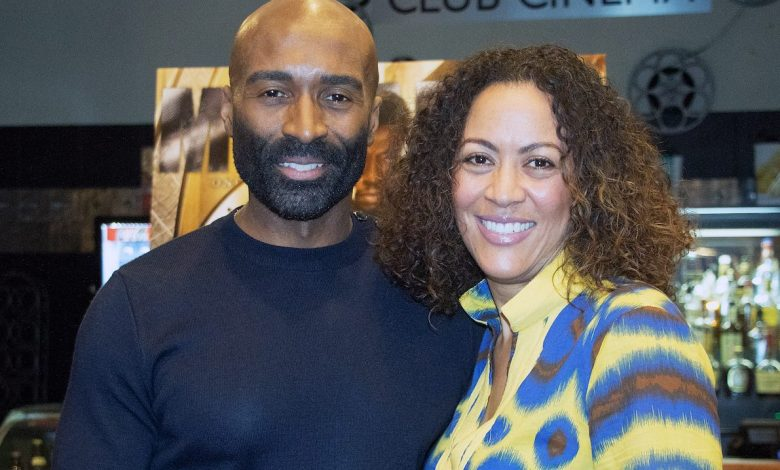 """Will Walters, publisher of Monarch magazine, and Dianne Wallace Booker, executive director of the U.S. Dream Academy, partnered to bring youth from the academy to the premiere of """"Black Panther"""" at the Majestic Theater in D.C. on Feb. 18. (Shevry Lassiter/The Washington Informer)"""