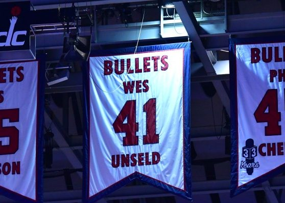 Washington Bullets franchise legend Phil Chenier's jersey is lifted to the rafters at Capital One Arena in D.C. during halftime of the Washington Wizards-Denver Nuggets game on March 23. (John De Freitas/The Washington Informer)