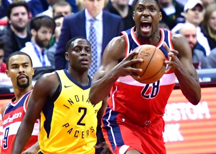 Washington Wizards center Ian Mahinmi protests a call during the Wizards' 109-102 win over the Indiana Pacers at Capital One Arena in D.C. on March 17. (John De Freitas/The Washington Informer)