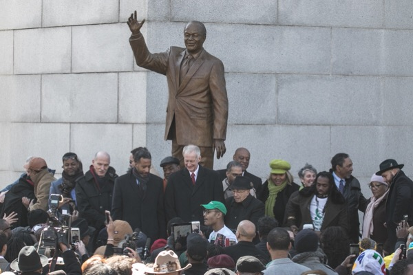 Current and past city council members stand in front of the new statue of Marion Barry outside the John H. Wilson Building ‪in northwest‬ D.C. during an unveiling ceremony on March 2. (Shevry Lassiter/The Washington Informer)