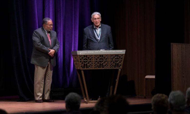 Kevin Gover (right), director of the Smithsonian National Museum of the American Indian, and Lonnie Bunch III, director of the Smithsonian National Museum of African American History and Culture, hold court during a March 3 symposium on racialized mascots and memorials. (Courtesy of Smithsonian)