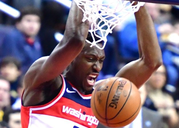 Washington Wizards center Ian Mahinmi dunks during the first half of the Wizards' 108-100 loss to the Denver Nuggets at Capital One Arena in D.C. on March 23. (John De Freitas/The Washington Informer)