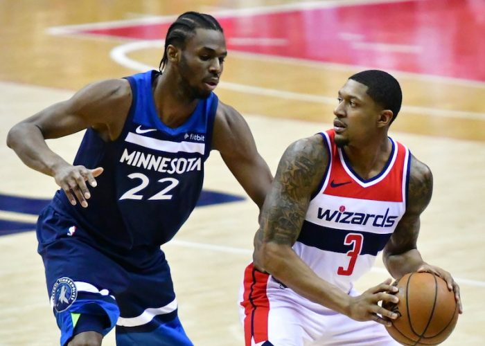 Washington Wizards guard Bradley Beal is defended by Minnesota Timberwolves guard Andrew Wiggins during Minnesota's 116-111 win at Capital One Arena in D.C. on March 13. (John E. De Freitas/The Washington Informer)