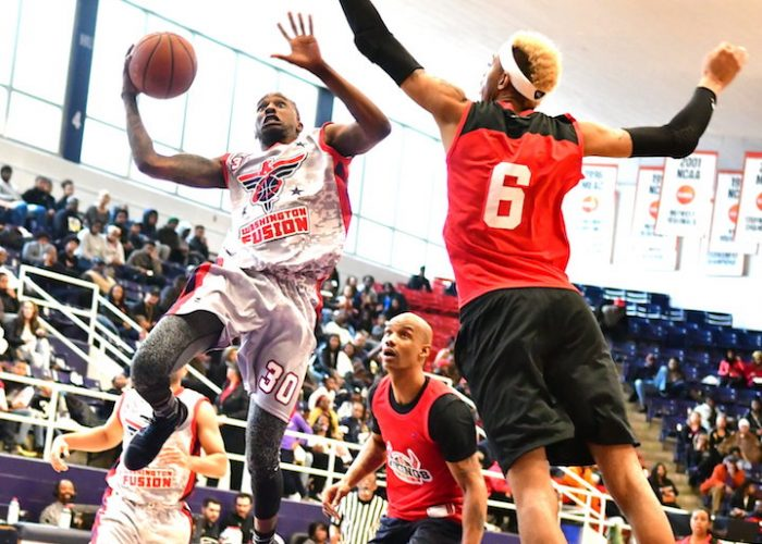 The Washington Fusion's Ezekial Maddox attempts a layup against the Chicago Vikings' Rashid Byrd during the Fusion's 118-91 win in an exhibition game for the new Global Mixed Gender Basketball League at Howard University's Burr Gymnasium in D.C. on March 24. (John E. De Freitas/The Washington Informer)