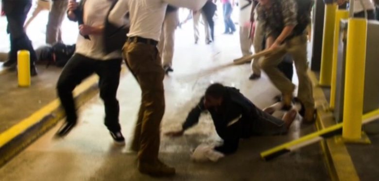 DeAndre Harris is beaten by participants in a White supremacists' rally in Charlottesville, Virginia, on Aug. 12. (Screen shot courtesy of CNN)