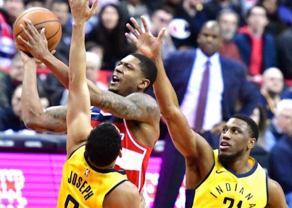 Washington Wizards guard Bradley Beal (3) drives to the basket against two Indiana Pacers defenders in the first quarter of the Wizards' 109-102 win at Capital One Arena in D.C. on March 17. (John De Freitas/The Washington Informer)