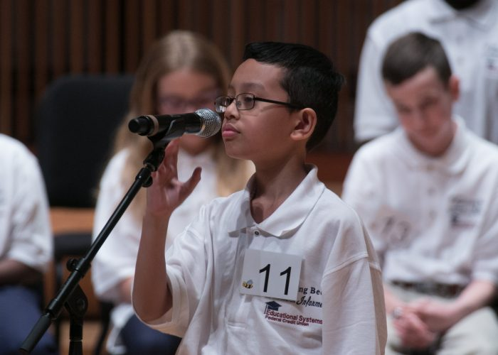 Drexel Pareja, a 5th grader at Cooper Lane Elementary School, participates in the 2018 Prince George's County Spelling Bee at the Clarice Smith Performing Arts Center in College Park, Md. (Shevry Lassiter/The Washington Informer)