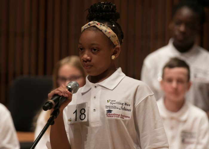 Kennedy McGee, a 5th grader at J. Frank Dent Elementary School, participates in the 2018 Prince George's County Spelling Bee at the Clarice Smith Performing Arts Center in College Park, Md. (Shevry Lassiter/The Washington Informer)