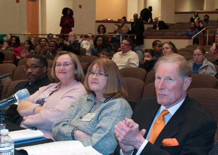 The 2018 Prince George's County Spelling Bee judges (L-R) Jeff Lyles, Joan McHale, and Helen Knowles with Moderator David Zahren at the Clarice Smith Performing Arts Center on the campus of Maryland University in College Park on Friday, March 16. (Shevry Lassiter/The Washington Informer)
