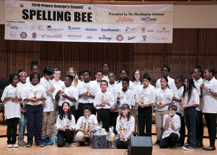 The 2018 Prince George's County Spelling Bee participants join the winner, Kayden Wilkins on stage at the Clarice Smith Performing Arts Center on the campus of Maryland University in College Park on Friday, March 16. (Shevry Lassiter/The Washington Informer)