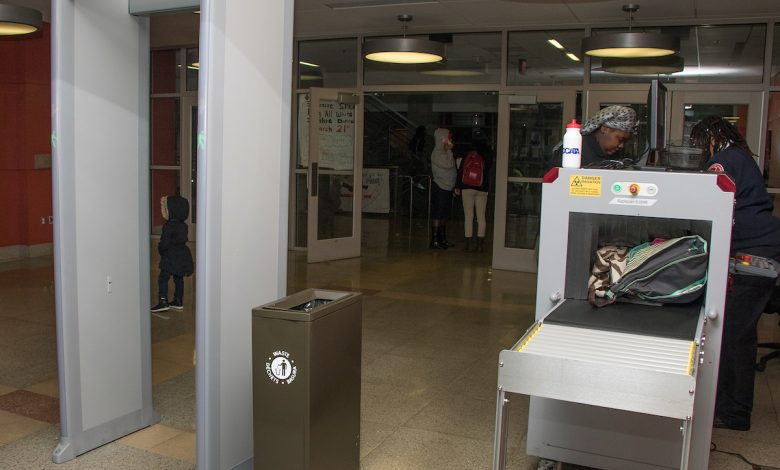The first line of security at most high schools in the District of Columbia are metal detectors and screening devices like those shown here at H.D. Woodson High School in Northeast staffed by security personnel. (Shevry Lassiter/The Washington Informer)