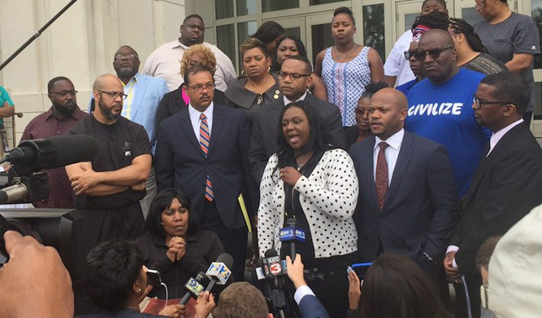 Quinyetta McMillon, the mother of Alton Sterling's son Cameron, speaks to reporters following the announcement that the officers involved in the shooting death of Alton Sterling would not be charged. (Michele McCalope/The Drum)