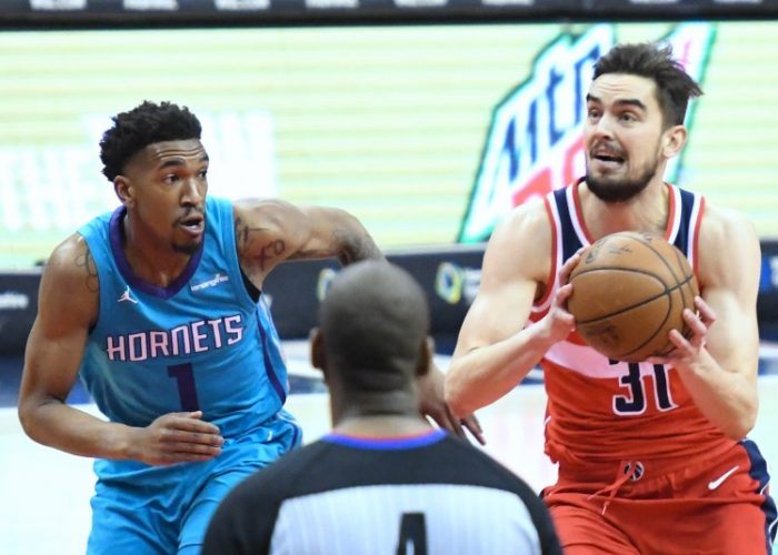 Washington Wizards guard Tomas Satoransky is defended by Charlotte Hornets guard Malik Monk during the Wizards' 107-93 win in D.C. on March 31. (John De Freitas/The Washington Informer)