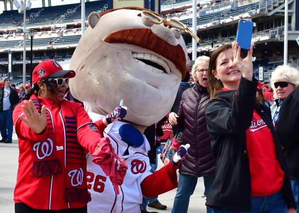 A fan takes a selfie with the Washington Nationals' Teddy Roosevelt mascot inside Nationals Park in southeast D.C. prior to the team's 2018 home opener against the New York Mets on April 5. (John E. De Freitas/The Washington Informer)