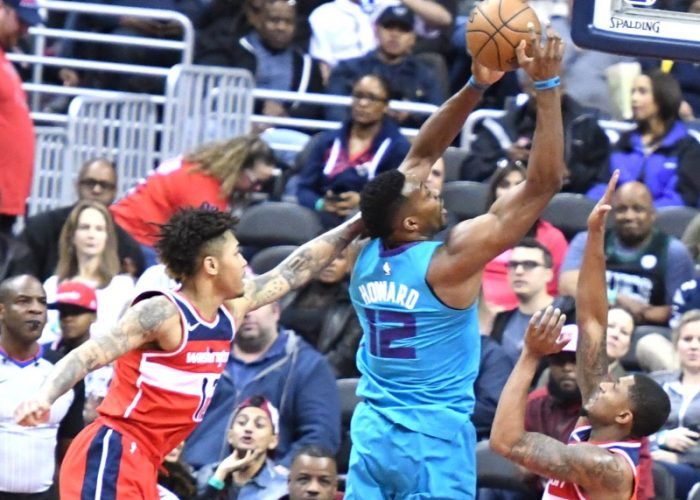 Charlotte Hornets center Dwight Howard fends off Washington Wizards forward Kelly Oubre Jr. (left) and guard Bradley Beal for a shot attempt during the Wizards' 107-93 win in D.C. on March 31. (John De Freitas/The Washington Informer)