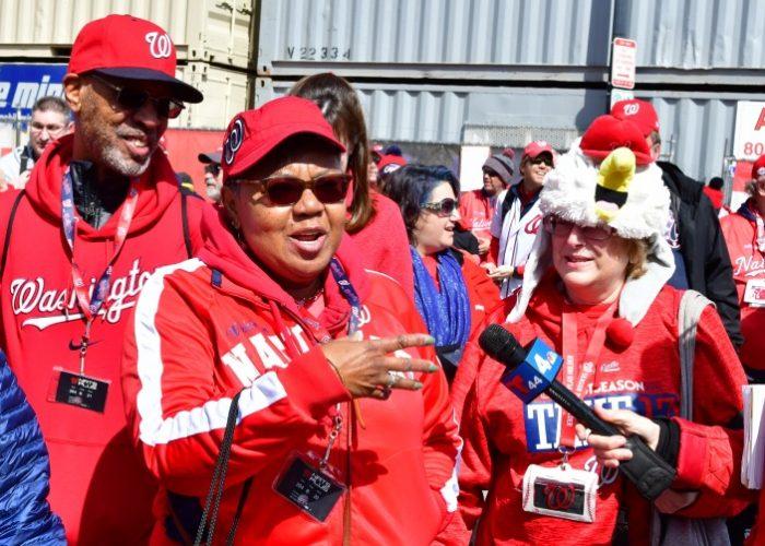 Several fans entering Nationals Park in southeast D.C. speak with a local television reporter prior to the Washington Nationals' 2018 home opener against the New York Mets on April 5. (John E. De Freitas/The Washington Informer)