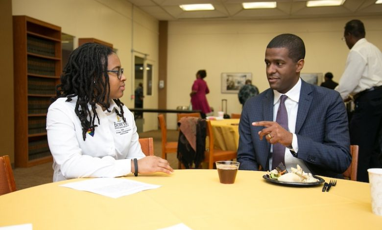 Phylecia Faublas, Bowie State University senior and president of the Student Government Association, chats with Bakari Sellers before introducing him as keynote speaker of the university's Martin Luther King Jr. Commemorative Symposium on April 4, the 50th anniversary of King's assassination. (Mark Mahoney/The Washington Informer)