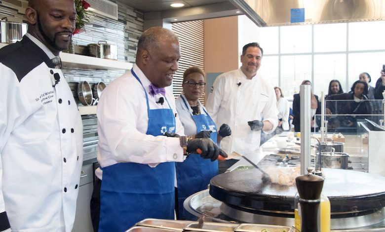 The Prince George's County Community College Culinary Arts Center Chef Edward Whitfield, County Executive Rushern L. Baker III, Prince George's Community College President Charlene Dukes and MGM National Harbor Executive Chef Jason Johnston prepare a meal in the kitchen of the new center during the grand opening on April 19. (Shevry Lassiter/The Washington Informer)