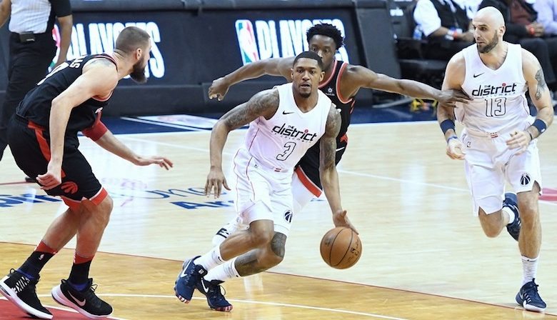 Washington Wizards shooting guard Bradley Beal (3) drives against Toronto Raptors center Jonas Valanciunas during the Wizards' 106-98 victory in Game 4 of the Eastern Conference first-round playoff series at Capital One Arena in D.C. on April 22. (John De Freitas/The Washington Informer)