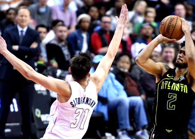 Atlanta Hawks guard Tyler Dorsey attempts a jumper over the outstretched arm of Washington Wizards guard Tomas Satoranky during the Hawks' 103-97 win at Capital One Arena in D.C. on April 6. (John De Freitas/The Washington Informer)