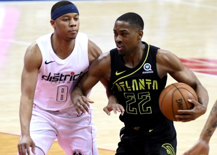 Washington Wizards guard Tim Frazier defends Atlanta Hawks guard Isaiah Taylor during the Hawks' 103-97 win at Capital One Arena in D.C. on April 6. (John De Freitas/The Washington Informer)