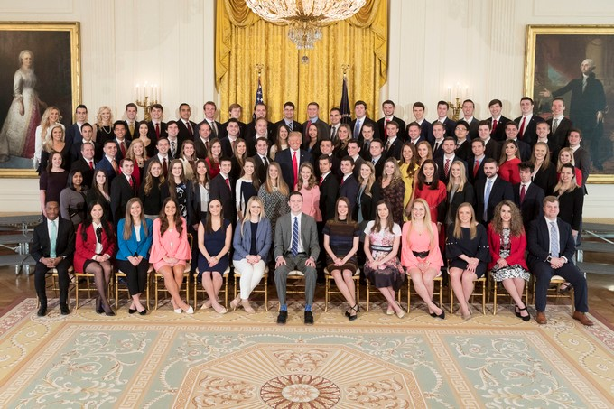 President Donald Trump (center) poses with the spring 2018 White House interns. (Courtesy of the White House)