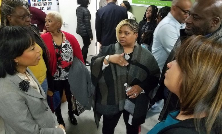 Prince George's County State's Attorney Angela Alsobrooks (left) talks with educators and residents after her Facebook Live chat to discuss her bid for county executive and plans for education reform at her campaign headquarters on April 5. (William J. Ford/The Washington Informer)