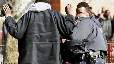 A Black youth is confronted by police. (Courtesy photo)