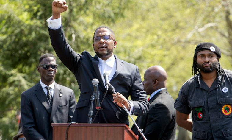 Attorney Malik Zulu Shabazz (center) speaks to those gathered outside the White House for the 10,000 Black Men's March on April 21. (Mark Mahoney/The Washington Informer)