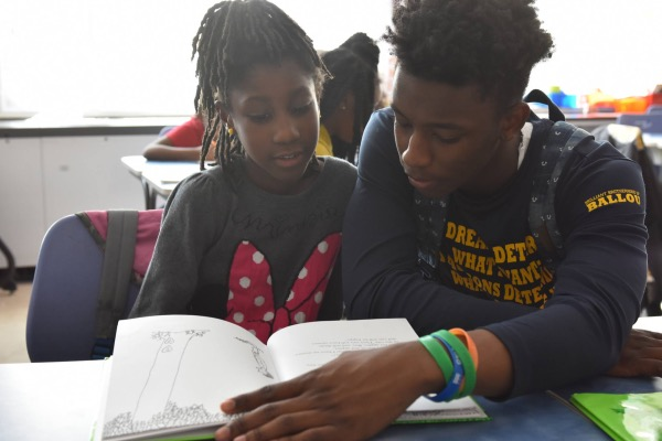 "The ""Reach Incorporated"" program aims to develop confident elementary school readers via tutoring by high school students. (Courtesy of DCPS)"