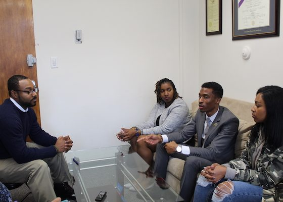 From left: Justin Hansford, executive director of Howard University's Thurgood Marshall Civil Rights Center, talks with law students Ky'eisha Penn, Elijah Porter and Hayley Tharpe. (Brigette White/The Washington Informer)