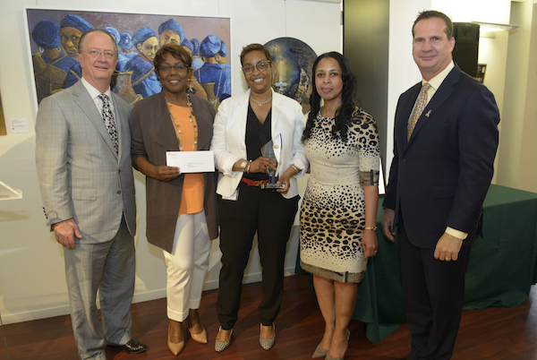 """Moneka Cunningham (center), Pepco external affairs manager, is recognized for her work with the Foundation for the Advancement of Music and Education at Exelon's """"Energy for the Community Volunteer"""" awards luncheon on May 23. Pictured are (from left) Exelon Senior Executive Vice President and Chief Strategy Officer William Von Hoene, FAME founder and Executive Director A. Toni Lewis, Cunningham, Pepco Region President Donna Cooper, Pepco Holdings Senior Vice President and COO Tyler Anthony. (Courtesy of Pepco/Exelon)"""