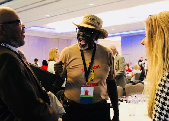 Ralph Cooper (center) chats with attendees at the three-day National Coalition for Homeless Veterans conference in northwest D.C. on May 30. Cooper, 76, helped establish the organization nearly 30 years ago. (Brigette White/The Washington Informer)