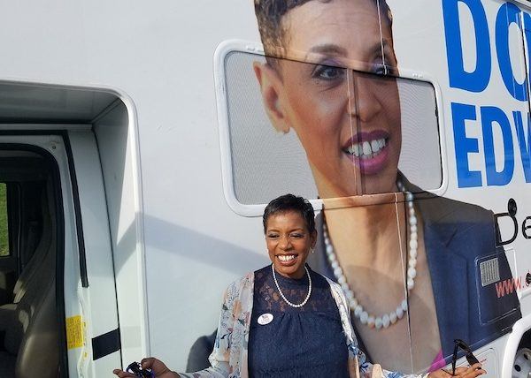Former U.S. Rep. Donna Edwards (D-Md.), who is running for Prince George's County executive, smiles beside her RV after voting at Oxon Hill Middle School during the Maryland primary election June 26. (William J. Ford/The Washington Informer)