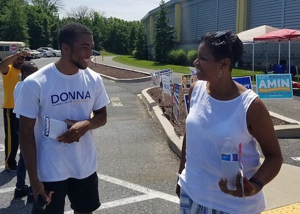 Former U.S. Rep. Donna Edwards (right), who is running for Prince George's County executive, chats with a volunteer outside the Wayne K. Curry Sports and Learning Complex in Landover, Maryland, on June 14, the first day of early voting in the state. (William J. Ford/The Washington Informer)
