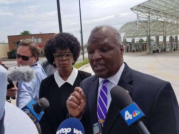 Prince George's County Executive and Maryland gubernatorial hopeful Rushern L. Baker III (right) speaks with reporters during a June 13 press conference at the Takoma Langley Transit Center after former opponent Valerie Ervin (left) announced she would end her bid and formally endorse Baker. (William J. Ford/The Washington Informer)