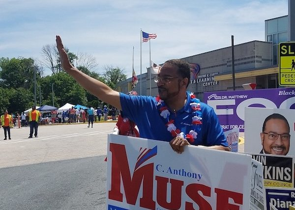 Maryland state Sen. C. Anthony Muse, who is running for Prince George's County executive, waves to motorists at the Wayne K. Curry Sports and Learning Complex in Landover on June 14, the first day of early voting in the state. (William J. Ford/The Washington Informer)