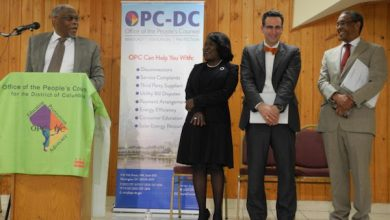 Sandra Mattavous-Frye (second from left) of the D.C. Office of the People's Counsel poses with D.C. Public Service Commission officials and others. (Courtesy of the D.C. Office of the People's Counsel)