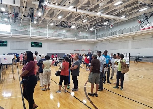 Voters line up in a gym inside the Southern Regional Technology and Recreation Complex in Fort Washington, Maryland, on June 14, the first day of early voting in the state. (William J. Ford/The Washington Informer)