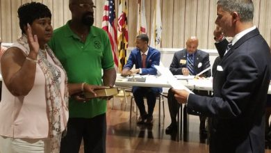 Cheryl Landis (left) is sworn in as the new chair of the Prince George's County Democratic Central Committee on July 24. Sydney Harrison (right), Prince George's County Court circuit clerk, conducts the swearing-in process. (William J. Ford/The Washington Informer)