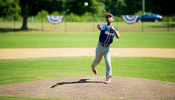 William Palmer of the Cheverly Boys and Girls Club throws out the first pitch as part of Major League Baseball All-Star festivities at renovated baseball field at Walker Mill Regional Park in Capitol Heights on July 14. (Courtesy of MLB)