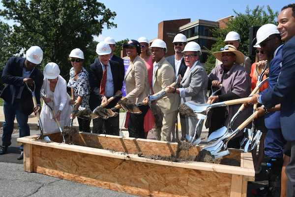 D.C. Mayor Muriel Bowser, joined by city officials and project developers, breaks ground for construction on the Abrams Hall Senior Apartments on the campus of the former Walter Reed Army Medical Center in northwest D.C. on July 16. (Roy Lewis/The Washington Informer)